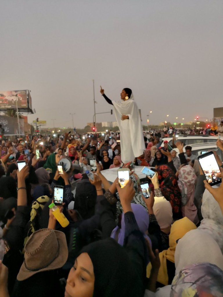 Alaa Salah, a modern Sudan Kandaka, speaks to crowd during protest